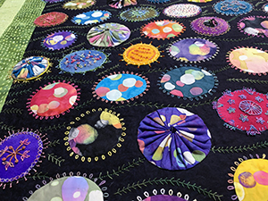 Flower basket quilt of fabric dot flowers